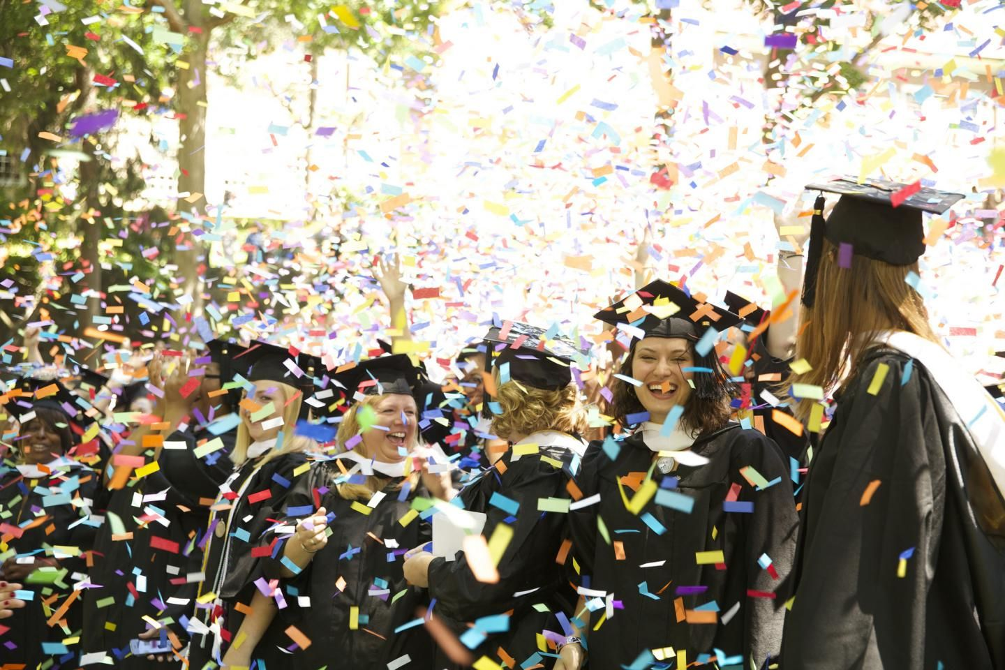 the famous confetti toss at commencement delights with an explosion of colors fluttering down from above