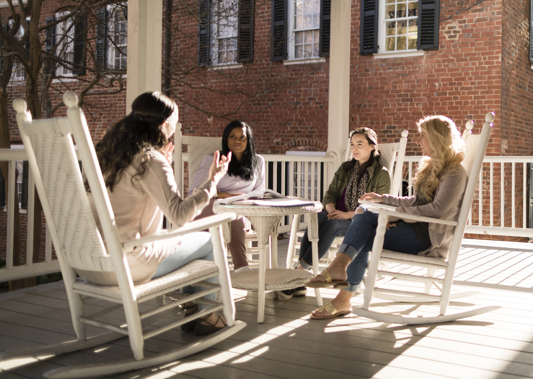 Adult students in rocking chairs engaged in discussion