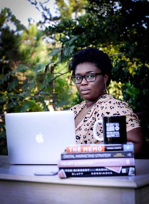 Shayla with books and laptop