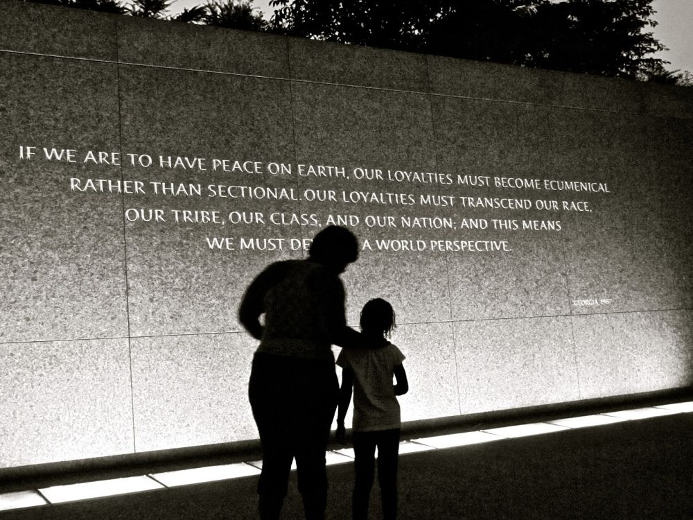 shadows reading MLK quote on wall