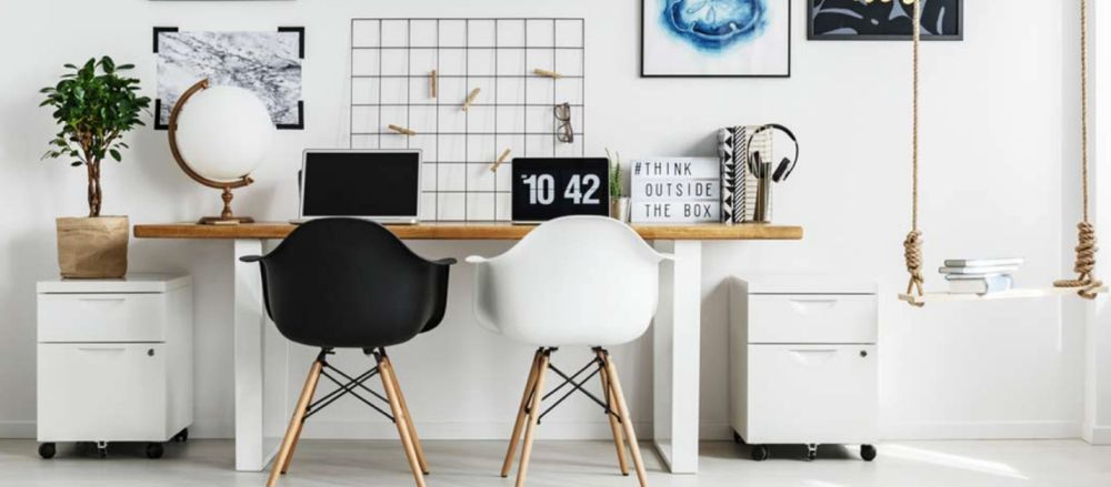 modern desk with black and white chairs