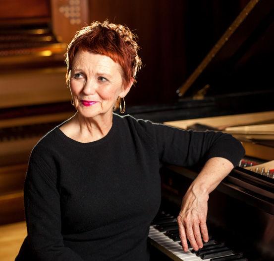 Photo of Barbara Lister-Sink at piano