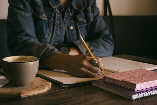 Shayla writing at desk