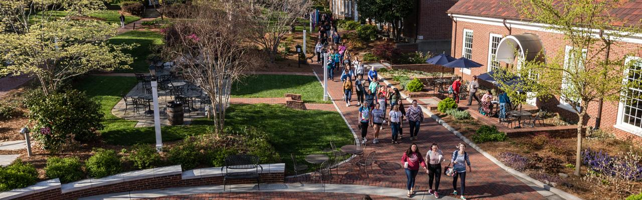 Aerial shot of center campus with many students walking