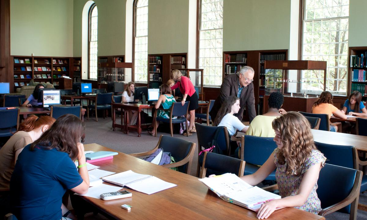 the library, an open space with students studying at tables