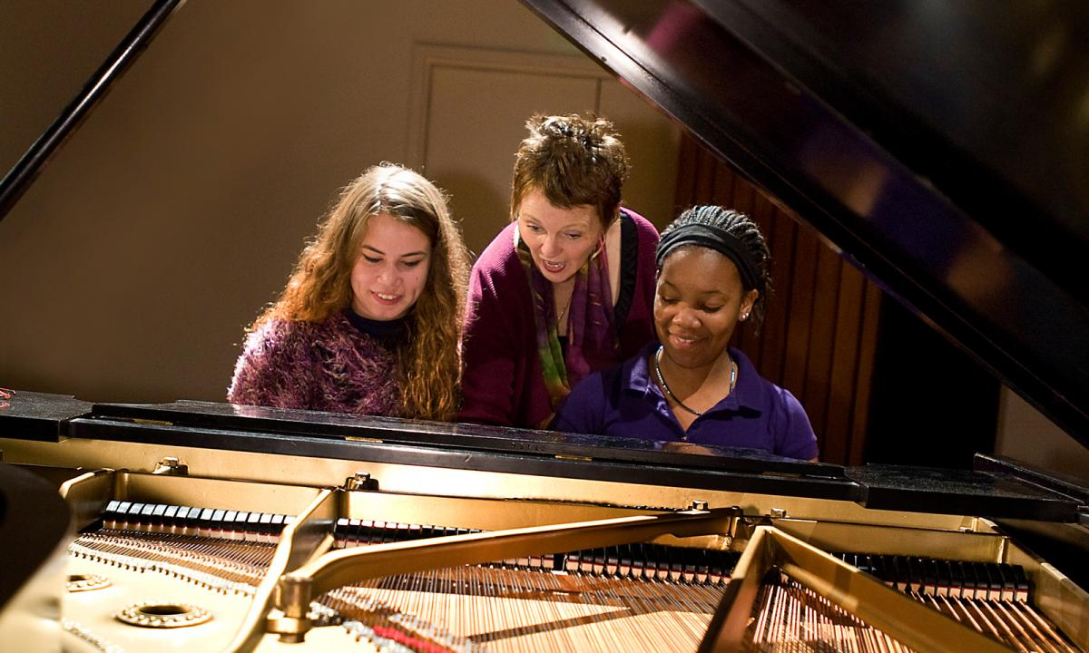 students at the piano with Barbara Lister-Sink