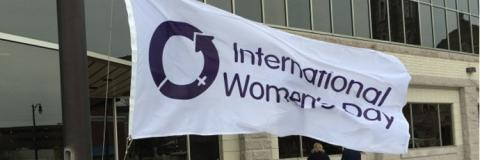 International Women's Day flag in the breeze