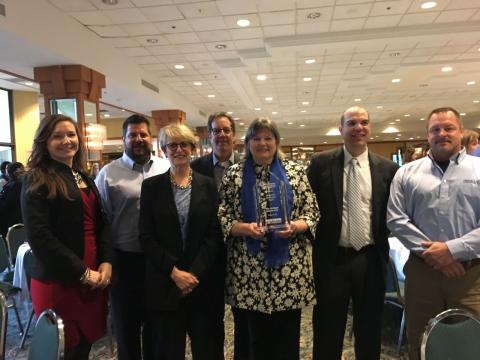 Salem leadership holding a 2016 Downtown Excellence Award