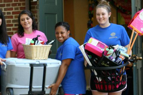 new students on move-in day carrying their belongings