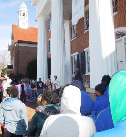 students gathered in front of main hall for MLK Day walk