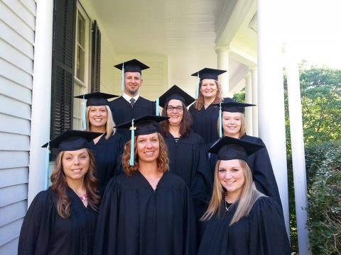 First Cohort Graduates from online-only degree program in cap and gown