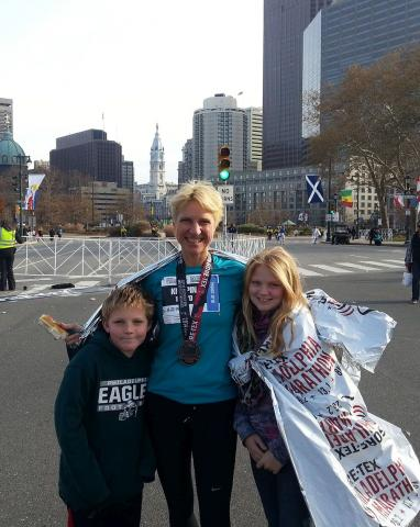 photo Krispin Barr with her children after completing the Philadelphia Marathon