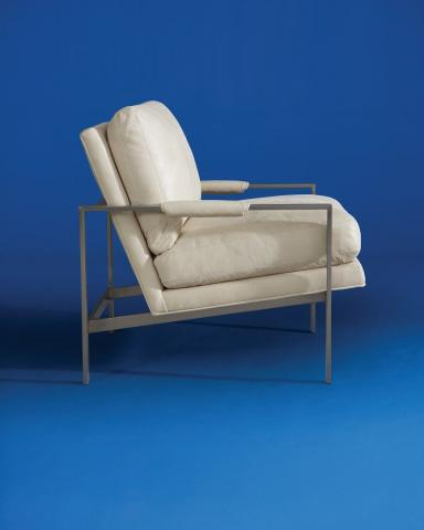 photo of iconoc Milo chair, white leather, modern against a royal blue background