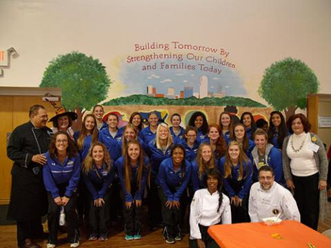 photo of student athletes, including the Salem College soccer team posing for a group shot at Second Harvest food bank