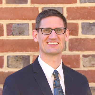 headshot of Tim Olson